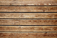 Rustic wood slats background. Closeup of a surface built of parallel rustic wood slats, to use as a background Stock Images