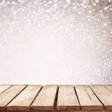 Rustic wood table in front of glitter bokeh lights Stock Photography