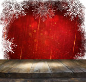 Rustic wood table in front of glitter red and gild bokeh lights  Royalty Free Stock Photos