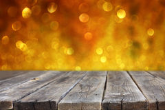 Rustic wood table in front of glitter silver and gold bright bokeh lights Stock Images
