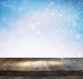 Rustic wood table in front of glitter silver and white bright bokeh lights Stock Photography