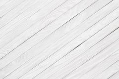 Boards painted in white, the background light wooden surface Stock Photography