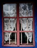 A rustic wood window frame with beautiful view Dimitrie Gusti National Village Museum, Bucharest, Romania royalty free stock photo