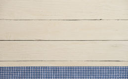Rustic wooden background with blue checkered fabric Royalty Free Stock Photos
