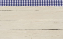 Rustic wooden background with blue checkered tape Royalty Free Stock Photo