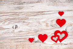 Rustic wooden background with bright red hearts and free text sp. Ace as a greeting for Valentine's Day Stock Photography