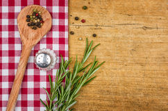 Rustic wooden background with a checkered tablecloth. And wooden spoon Royalty Free Stock Photos