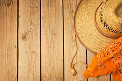 Rustic wooden background with cowboy hat and bandanna. View from above Royalty Free Stock Photography
