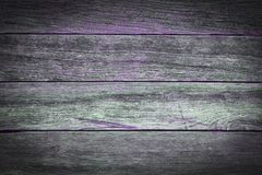 A rustic wooden background with purple details. A rustic wooden background made of weathered boards with purple details Royalty Free Stock Photos
