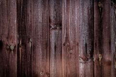 Wooden boards burgundy color fence texture macro stock photos