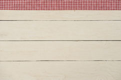 Rustic wooden background with red checkered fabric. Rustic white wooden background with red checkered fabric tape Stock Image