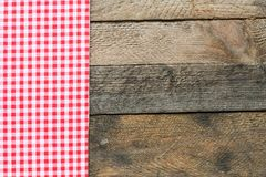 Rustic wooden background with a red checkered table cloth. Vinage style wooden backgrond with piece of cloth Stock Photography