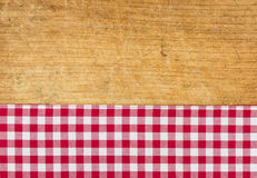 Rustic wooden background. With a red checkered tablecloth Royalty Free Stock Photography