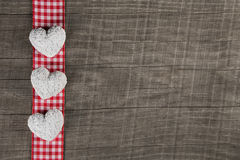 Rustic wooden background with red white checkered frame and thre Stock Photos