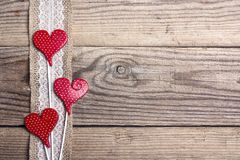Rustic wooden background with sacking border and hearts. Copy sp. Ace. Top view royalty free stock image