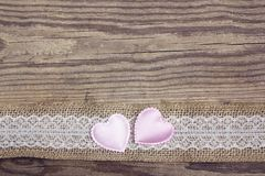Rustic wooden background with sacking border and hearts. Copy sp. Ace. Top view stock photography