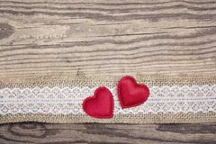 Rustic wooden background with sacking border and hearts. Copy s. Pace. Top view royalty free stock photography