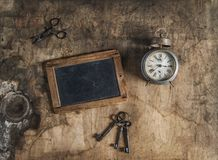 Rustic wooden background vintage accessories scissors keys alarm Royalty Free Stock Photo