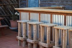 Rustic wooden bar and stools on empty patio stock image