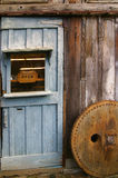 Rustic wooden barn door. With rusty metal handles and Open sign in the window royalty free stock photos