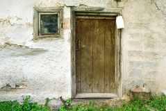 Rustic wooden barn door with white milk can Stock Image