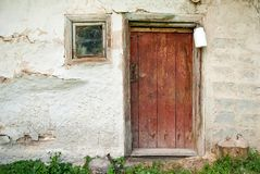 Rustic wooden barn door with white milk can Royalty Free Stock Photos