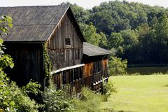 Rustic wooden barn and pond Stock Images