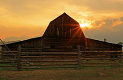 Rustic wooden barn with sun beams. Royalty Free Stock Image