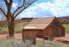 Rustic wooden barn and tractor. Stock Photography