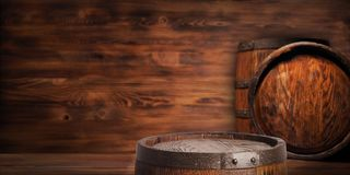 Rustic wooden barrel on a night background.  Stock Image