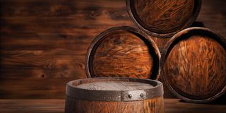 Rustic wooden barrel on a night background.  Stock Photo
