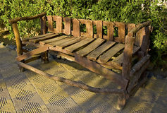Rustic wooden bench. Wooden rustic bench in park Stock Images