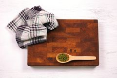 Rustic wooden board, checkered napkin and lentils seeds with cop royalty free stock image