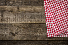 Rustic wooden boards with a checkered tablecloth. Rustic wooden boards with a red checkered tablecloth Royalty Free Stock Images