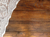 Rustic wooden boards with lace tablecloth Royalty Free Stock Photography