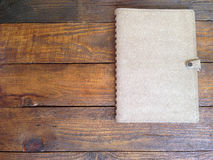 Rustic wooden boards with notebook Stock Image