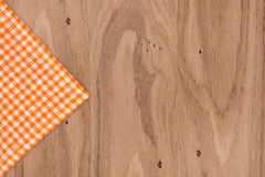 Rustic wooden boards with a orange checkered Royalty Free Stock Photography
