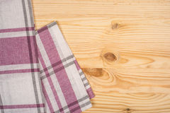 Rustic wooden boards with a red checkered tablecloth Stock Photo