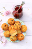 Rustic wooden breakfast background with fresh scones and raspberry jam Royalty Free Stock Photos