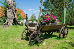 Rustic wooden carriage with flower composition Stock Photo