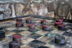 Rustic wooden checkers Stock Images