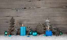 Rustic wooden christmas background with two blue or turquoise ca stock images