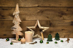 Rustic wooden christmas card with candles and handmade decoratio Stock Photo