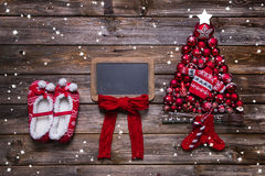 Rustic wooden christmas card with red sign and decoration. Stock Image