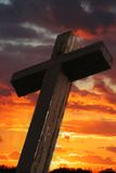 Rustic Wooden Cross Against Sunset Stock Photo
