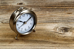 Rustic wooden desktop with retro clock Stock Photography
