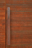 Rustic Wooden Door with Metal Handle Bar Royalty Free Stock Images