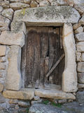 Rustic wooden door on old stone house Stock Image