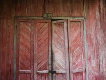 Rustic wooden door of rural house. In Mandalay, Myanmar stock image