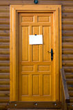 Rustic wooden door with a sign Royalty Free Stock Photo